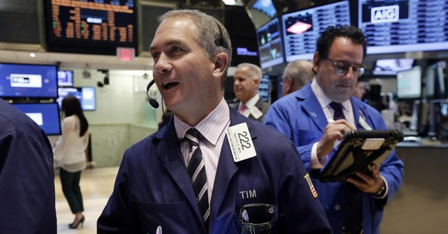 Stocks close mostly higher on earnings; Apple up