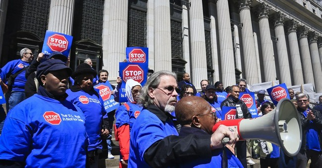 Postal workers' unions protest Staples program