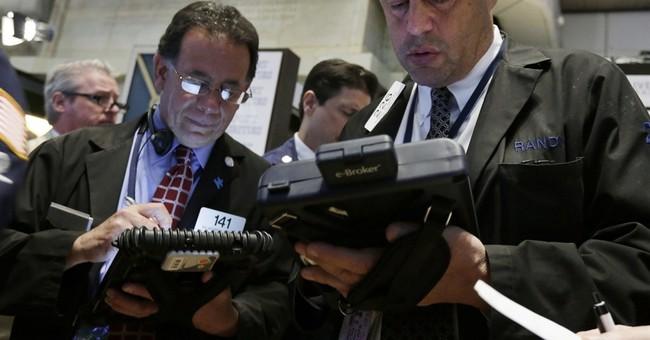 Stocks edge higher on earnings gains; Apple up