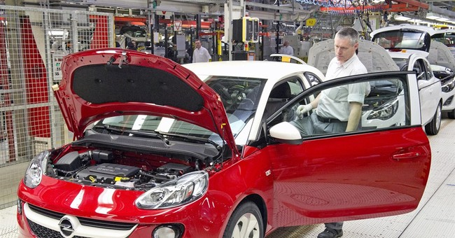 GM profit sinks; CEO sees no recall hit to sales