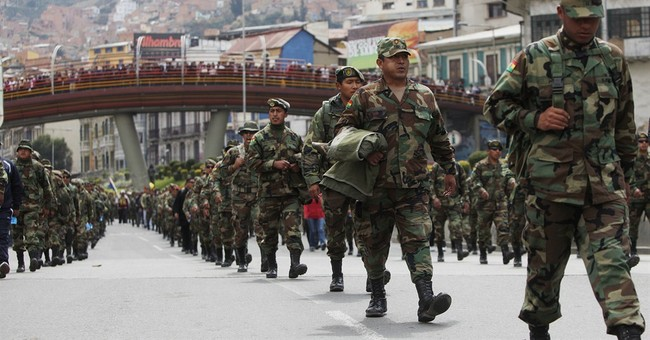 Bolivia fires hundreds of protesting soldiers
