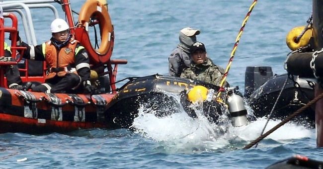 Divers battle darkness and fear to find bodies