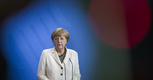 Germany's Merkel threatens new Russia sanctions
