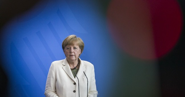 Germany's Merkel threatens new Russia sanctions