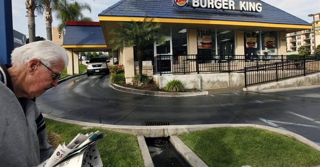 Burger King's profit rises on cost cuts