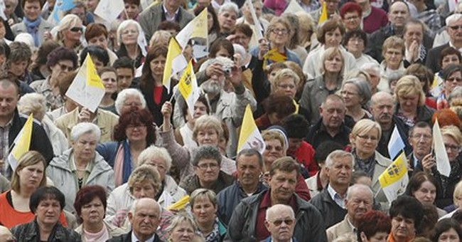 Poles applaud beloved John Paul II's sainthood