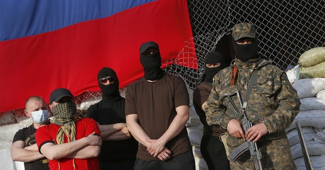 Observers held in Ukraine speak under armed guard