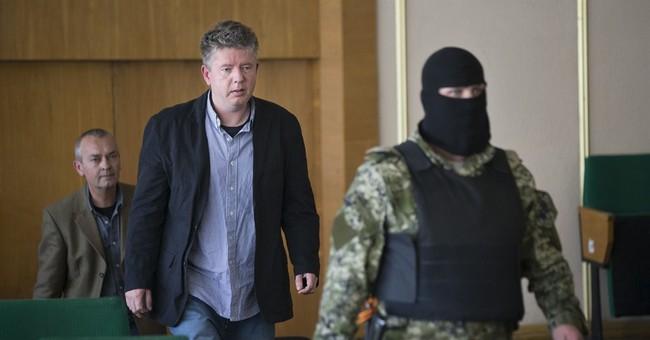 Observers held in Ukraine speak under armed guard