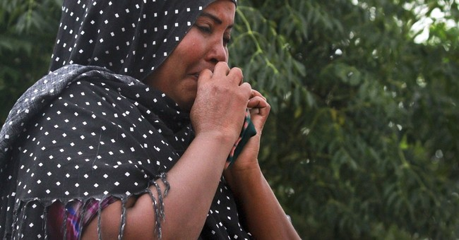 Stowaway boy's refugee mom cries for son