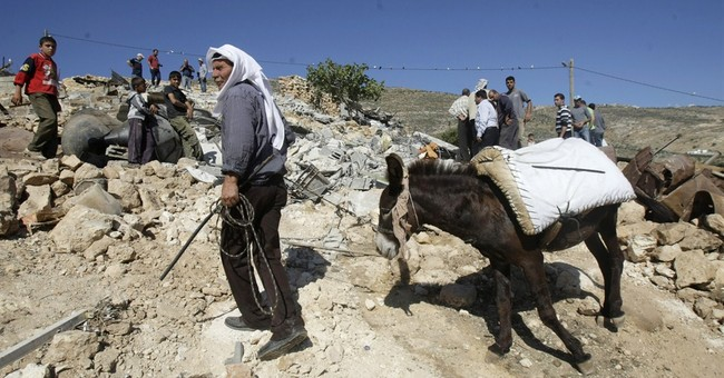 Group: Israel upped settlement work during talks