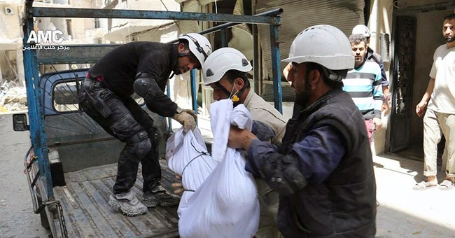 Attacks in 2 Syrian cities kill at least 54