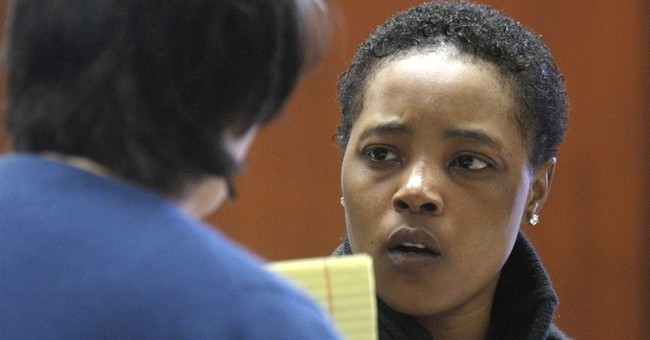 Woman admits tossing dog into traffic over dispute