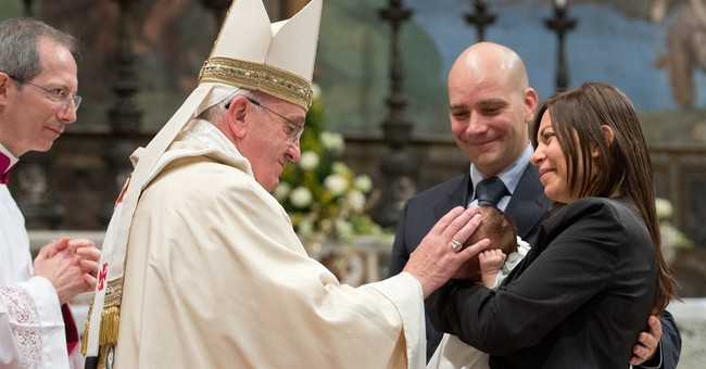 Pope  baptizes 32 babies in Sistine Chapel