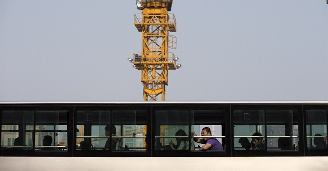 China rejects sign it may soon be No. 1 economy