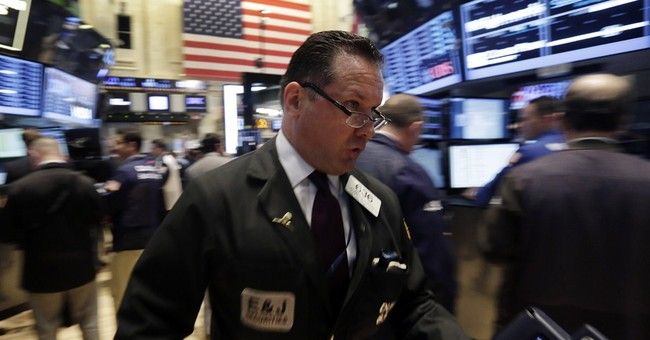 Dow closes at record as Fed keeps cutting stimulus