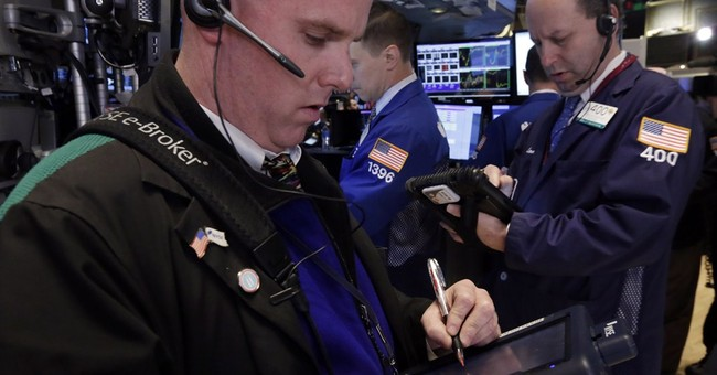 Dow closes at a record high, erases loss for year