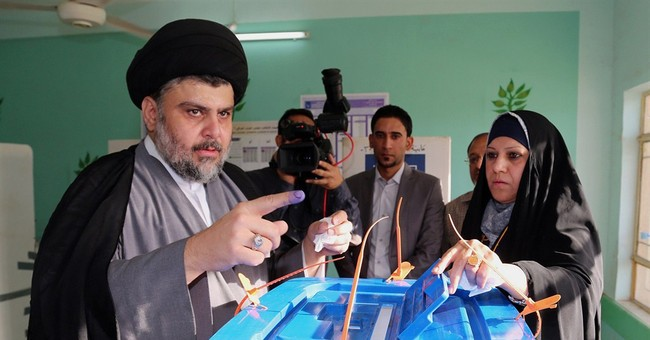 Iraqis vote in an election without foreign troops