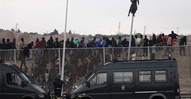 700 migrants rush at Spain's border, 140 breach it