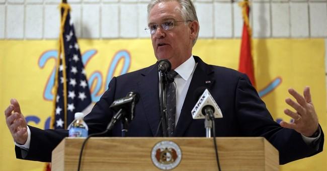 Missouri governor vetoes income tax cut