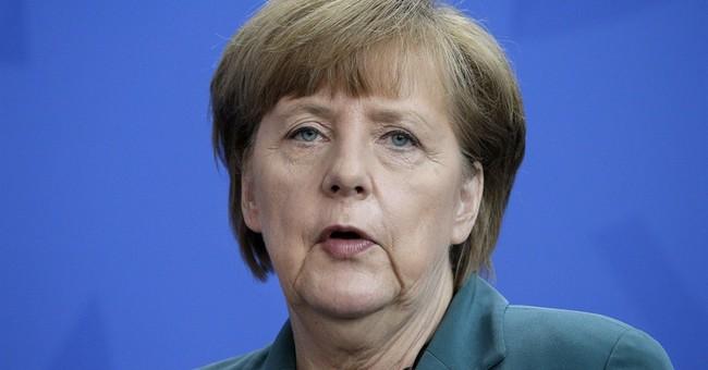 Merkel presses Putin for release of OSCE hostages