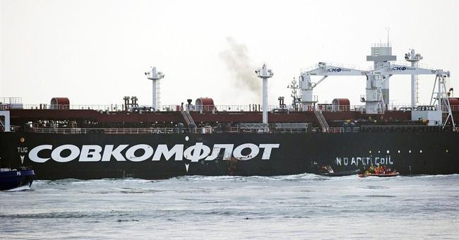 Police break Greenpeace blockade on Russian tanker