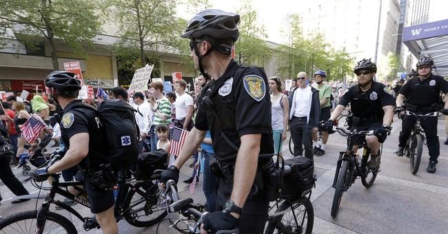 Hundreds march in Seattle; police make arrests