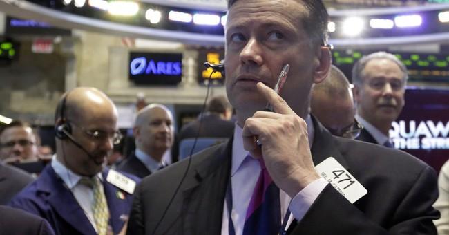 Stocks inch lower on mixed earnings, Ukraine