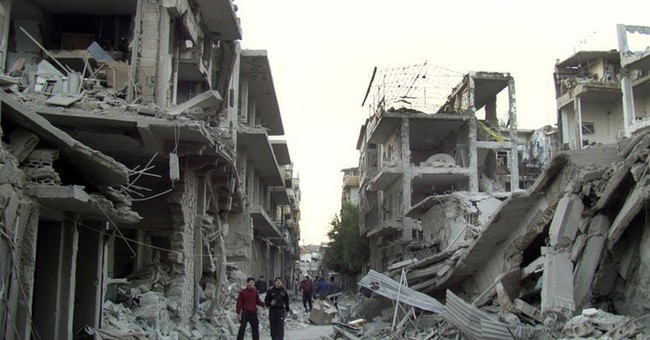 Activists: Syrian rebels begin evacuating their last bastions in central city of Homs