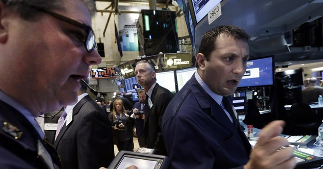 Stocks finish lower on mixed earnings, Ukraine