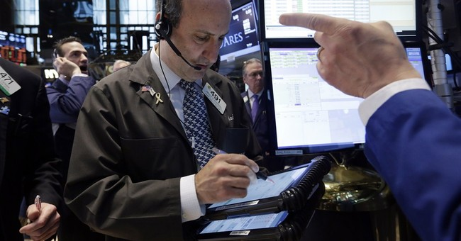 Stocks finish lower on mixed earnings, Ukraine