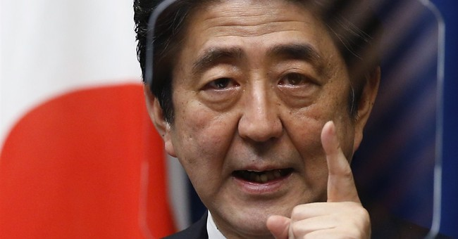 Japan split over revision to pacifist constitution