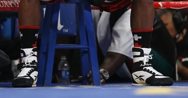 Floyd Mayweather Jr. wins a tough fight