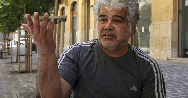Syrian novelist hurts for his country's bloodbath