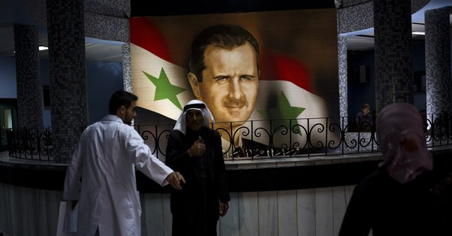 Assad to face 2 others in Syrian presidential poll
