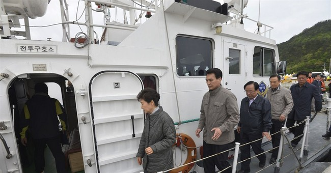 South Korea leader visits kin of ferry missing