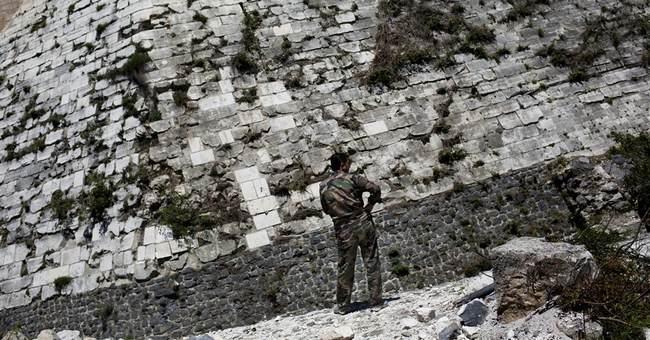 Syria's historic Crusader castle damaged by war
