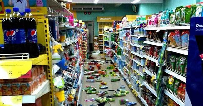 Quake cracks roads in north Thailand, 1 killed