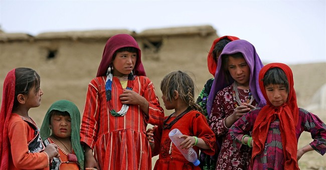 AP PHOTOS: Survivors struggle after Afghan slide