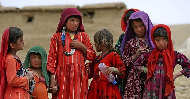 AP PHOTOS: Survivors struggle after Afghan slide