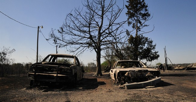 Oklahoma residents survey wildfire damage; 1 dead