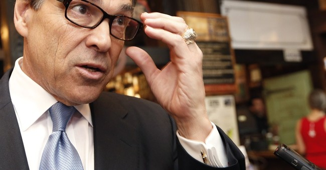 Perry says he didn't seek deal over vetoed funding