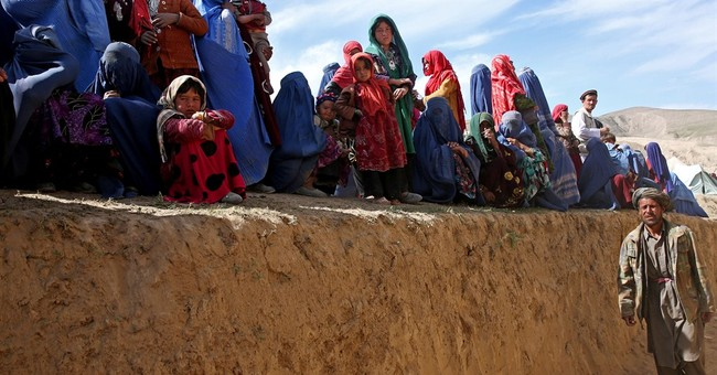 Karzai pledges aid to victims of Afghan landslide