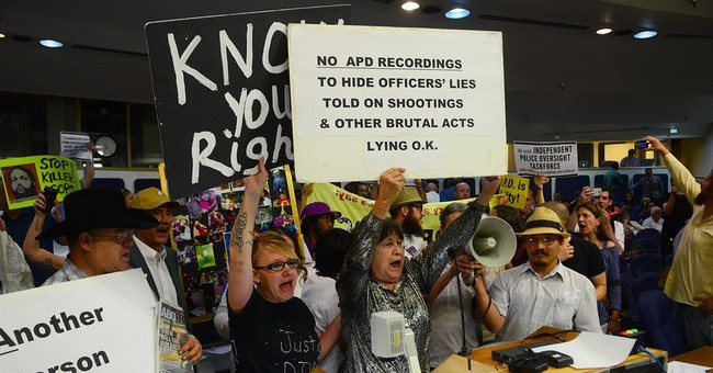 Protesters vow more pressure over police shootings