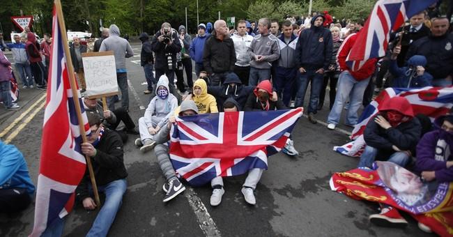 Northern Ireland police chief defends Adams arrest