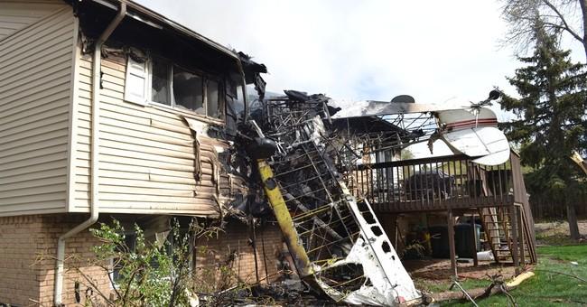 Pilot crashes into former home north of Denver