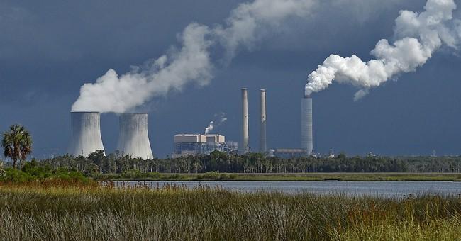 Duke posts loss declining value of power plants