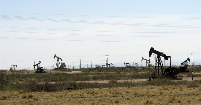 New Mexico oil country struggles as cities boom