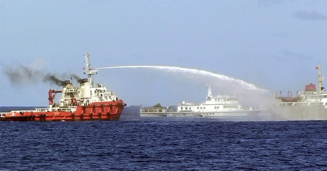 China insists it has right to put rig off Vietnam