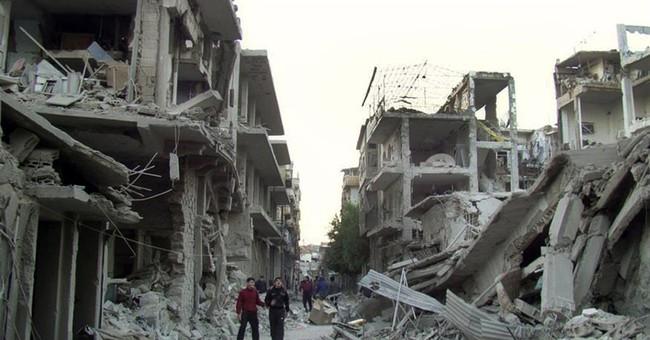 Syria rebels surrender strongholds in Homs