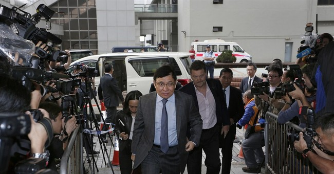 HK graft trial of billionaire brothers opens